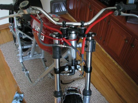 Click to view full size image  ==============  Front view covered harness' and cables, brake hoses mounted, Pseudo fork brace
