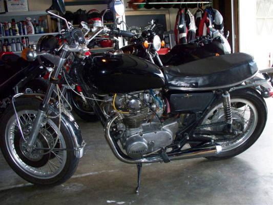Click to view full size image  ==============  1972 XS2 My 72. Has TX750 front end and rear wheel, VM34 Mikuni's, and Mike's XS reverse cone megaphones, speedo & tach and air filters. My daily rider.